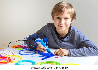 Happy child creating new 3d object with 3d printing pen