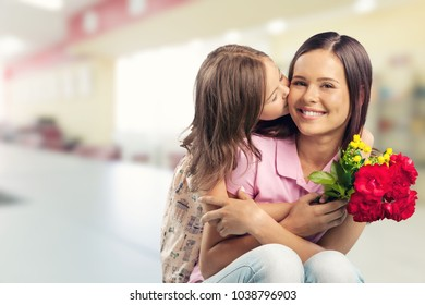 Happy child daughter and mother - Shutterstock ID 1038796903