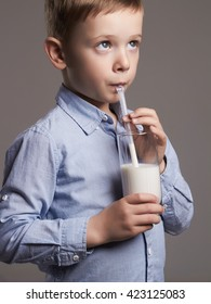 happy Child drinking milk.Little smiling Boy enjoy milk cocktail. Healthy life
