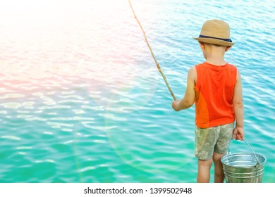 happy child fishes off the coast in nature