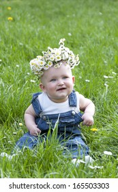 happy child in a flower wreath outdoors