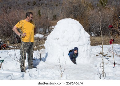 Happy child gets out of the Eskimo home - igloo