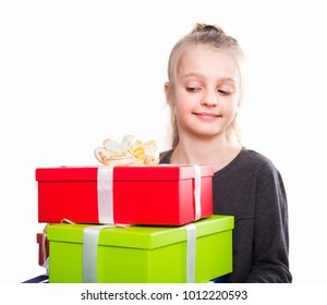 happy child with a lot of gift boxes in hands on isolated background