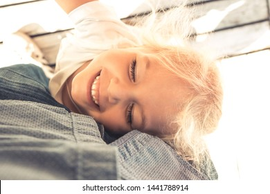 Happy child girl embracing parent family lifestyle