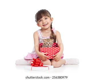 happy child girl holding gift box with cat kitten