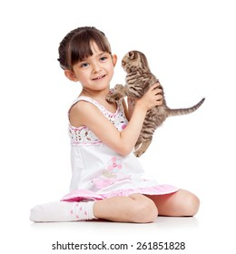 happy child girl holding kitten isolated on white