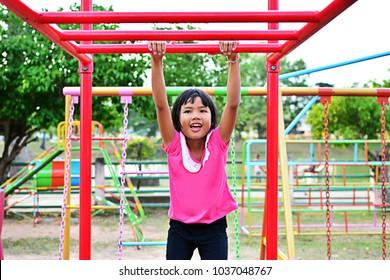 Happy child girl playing at playground.