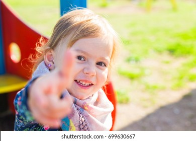 happy child girl showing thumbs up