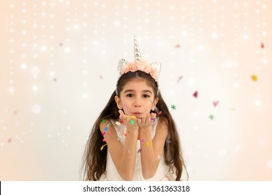 Happy Child Girl in Unicorn Concept Party