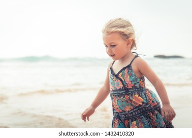 Happy child girl walking on beach tropical island during summer holidays concept carefree childhood travel lifestyle