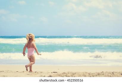 happy child going to swim at beach