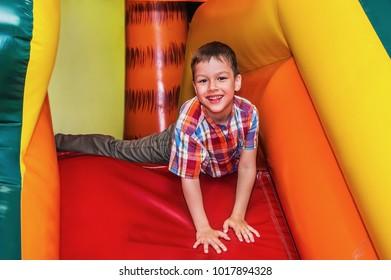 Happy child having fun in the children's playroom