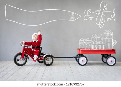 Happy child having fun on Christmas time. Kid playing at home. Xmas holiday concept