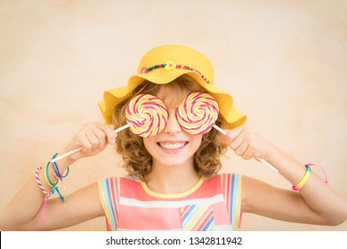 Happy child having fun on summer holidays. Portrait of teenager girl indoor