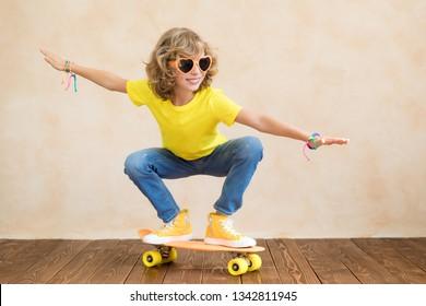 Happy child having fun on summer holidays. Portrait of teenager girl indoor