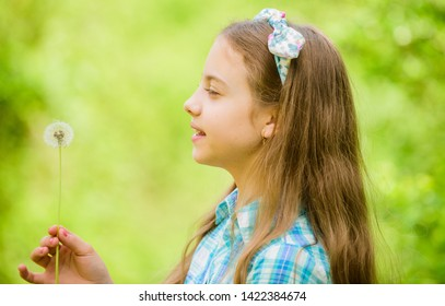 happy child hold blowball. dandelion. Spring holiday. Womens day. little girl and with taraxacum flower. Natural beauty. Childhood happiness. summer. Working in green environment. Rancho and country.