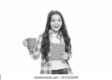 happy child hold note book and tea cup. ready for reading. little business lady. back to school. surprised school gorl drink tea. time for rest. Spend nice time with favorite book. reading book lover.