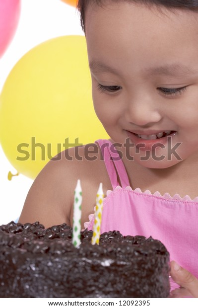 happy child holding a delicious chocolate cake