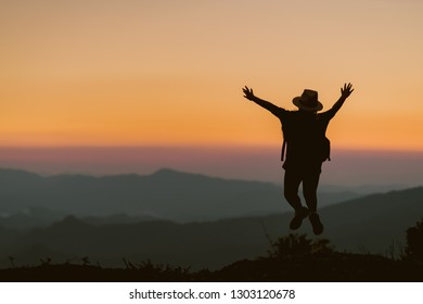 Happy child jump on the background of the sunset in the mountain