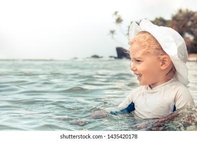 Happy child kid enjoy swimming sea during summer beach holidays vacation lifestyle