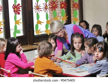 happy child kids group have fun and play at kindergarden indoor preschool education concept with  teacher