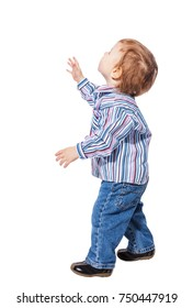 Happy child little boy standing looking up isolated on white