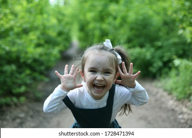 Happy child. Happy little girl found. Child alone in the forest. Unattended child. Тhe little girl was lost alone in the forest.
