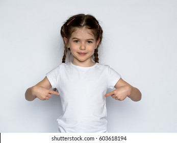 Happy child, little girl in a white T-shirt isolated on white background.Space for Your Text.