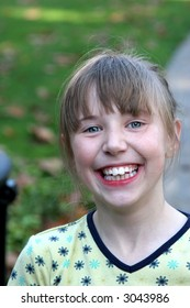 A happy child in need of braces