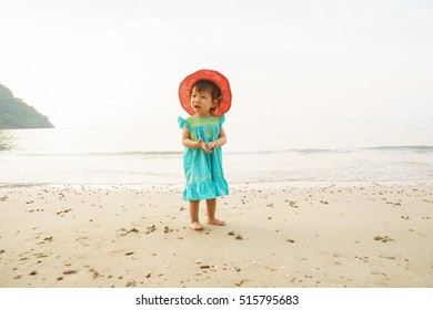 Happy child on the coast of tropical sea