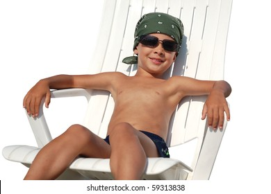 Happy child on sunbed isolated on white background