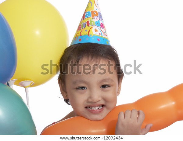happy child with party hat and colorful balloons