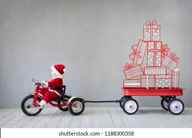 Happy child paying at home. Kid having fun on Christmas time. Xmas holiday concept