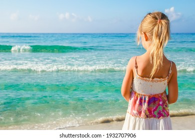 happy child playing by the sea outdoors