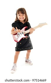 Happy child playing with a guitar .