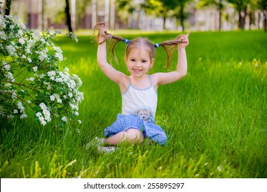 happy child playing in a spring garden
