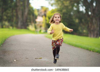 Happy Child Running in the Park