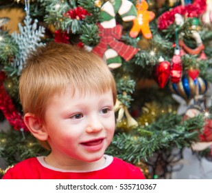 Happy child in Santa Claus wearing open  Christmas present