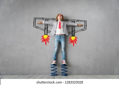 Happy child standing on spring. Success, creative and idea concept