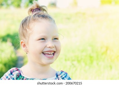 Happy Child in Summer.  Beautiful Smiling Girl. Happy Children. Healthy Kids. Spring Time.