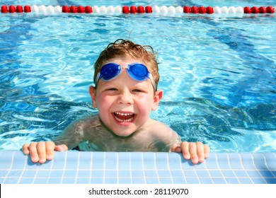 Happy child in a sunny swimming pool
