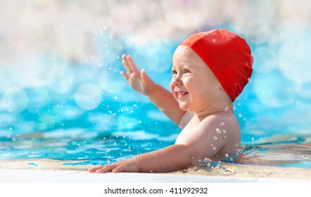 happy child with swimming pool cap have fun in a pool