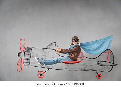 Happy child travel by plane. Imagination, creative and idea concept