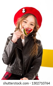 Happy child with watermelon candy. Is laughing