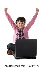 Happy child winner sitting with a laptop on a over white background