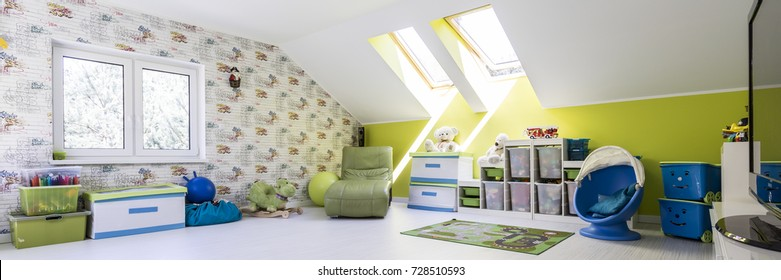 Happy childhood- colorful spacious child room in attic