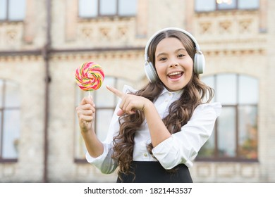 Happy childhood concept. Smiling pupil. Real success. Happy song. Leisure and rest. Happy kid outdoors. Cheerful schoolgirl. Schoolgirl listening music. International childrens day. Happiness concept.