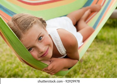 Happy childhood - Cute girl in colorful hammock