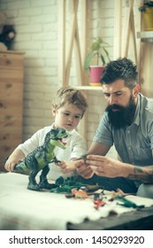 Happy childhood full of playful learning. Empowers children to become lifelong learners. Dinosaurs game. Father plays with his son in the Jurassic period.