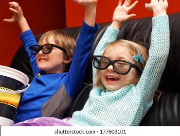 Happy children in 3d glasses watching movie at home